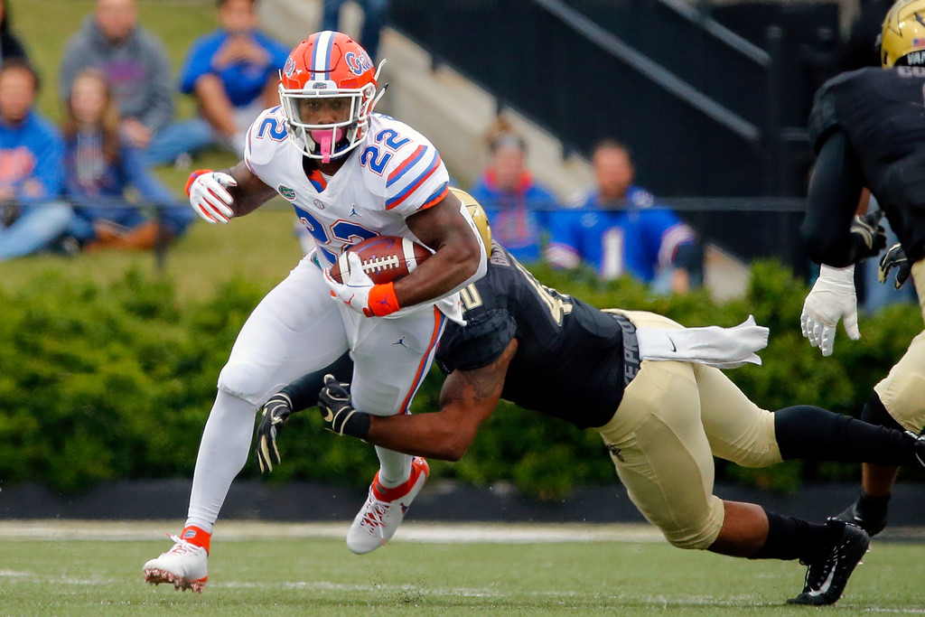 Florida Gators running back Lamical Perine rushing the ball against the Vanderbilt Commodores