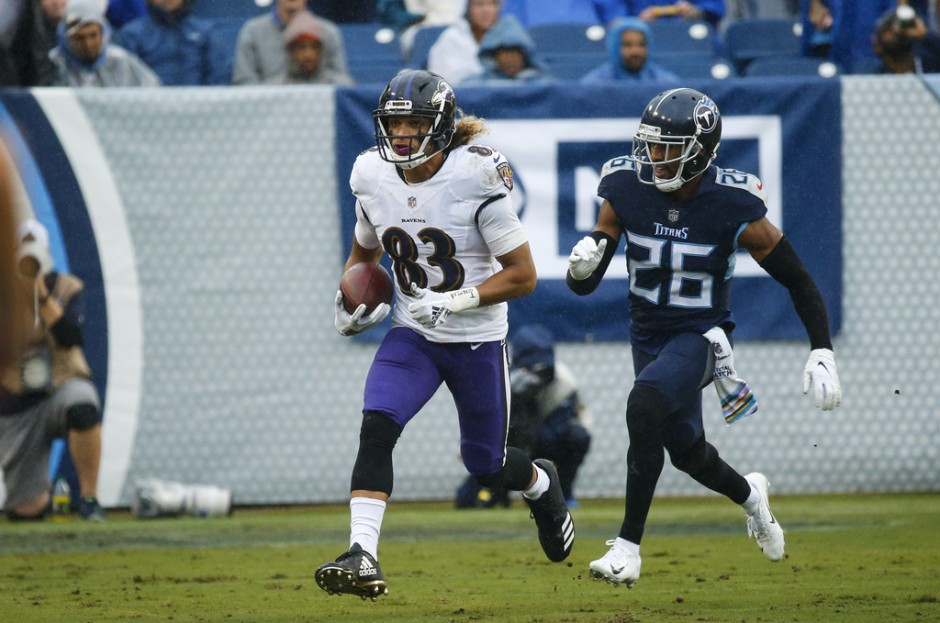Tennessee Titans cornerback Logan Ryan attempting to tackle Baltimore Ravens wide receiver Willie Snead