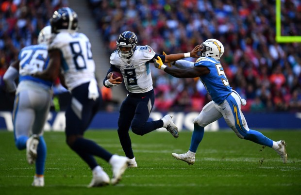 Thursday, November 29, 2018 1:53 AM  Tennessee Titans quarterback Marcus Mariota scrambles with the ball against the Los Angeles Chargers
