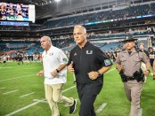 Former Miami (Florida) Hurricanes head coach Richt heads to midfield after the game against the North Carolina Tar Heels