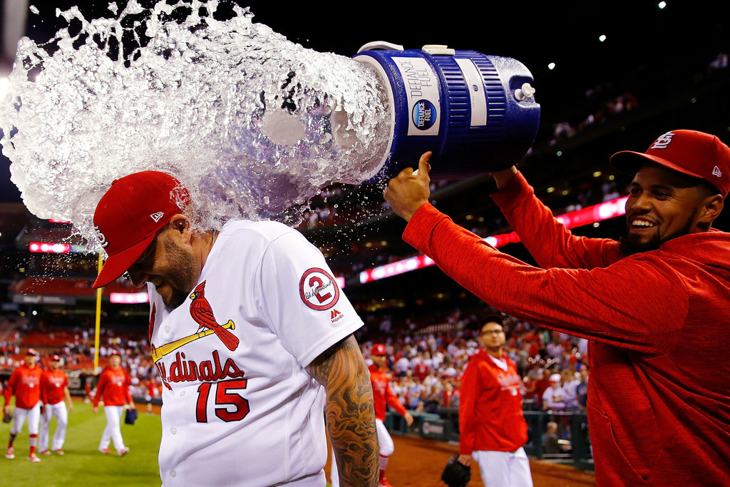 St. Louis Cardinals catcher Francisco Peña douses first baseman Matt Adams after beating the San Francisco Giants