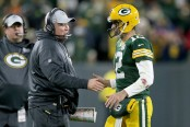 Former Green Bay Packers head coach Mike McCarthy celebrates a touchdown with Aaron Rodgers against the San Francisco 49ers