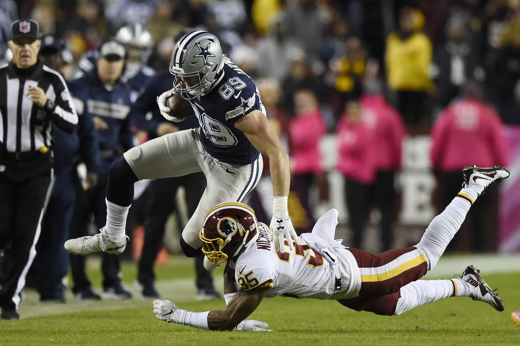 Washington Redskins safety Montae Nicholson attempting to tackle Dallas Cowboys tight end Blake Jarwin