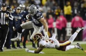 Washington Redskins safety Montae Nicholson attempting to tackle Dallas Cowboys tight end Blake Jarwin
