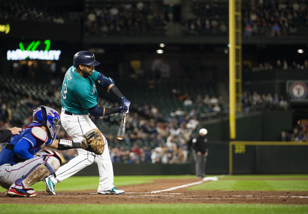 Former Seattle Mariners slugger Nelson Cruz hits a double against the Texas Rangers