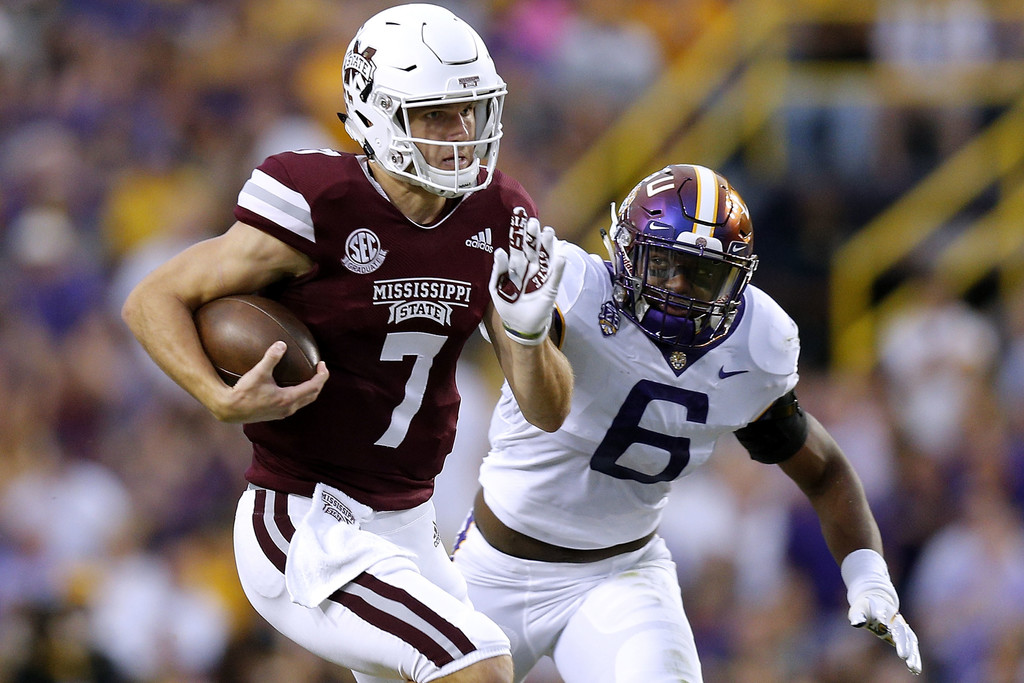 Mississippi State Bulldogs quarterback Nick Fitzgerald runs with the ball against the LSU Tigers