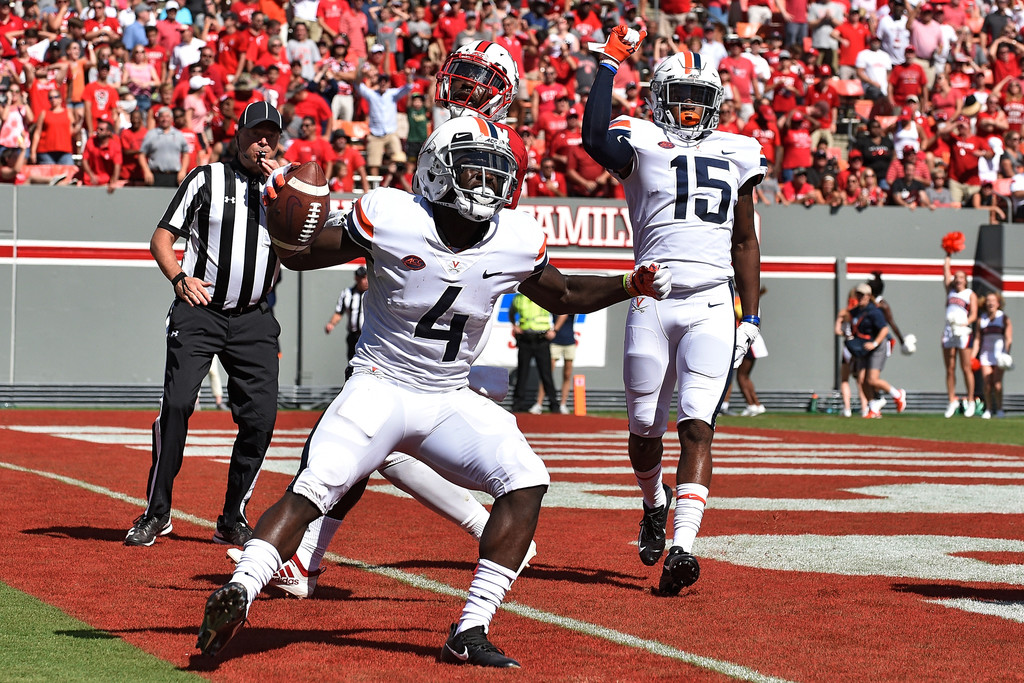 Virginia Cavaliers wide receiver Olamide Zaccheaus reacts after scoring a touchdown against the North Carolina State Wolfpack