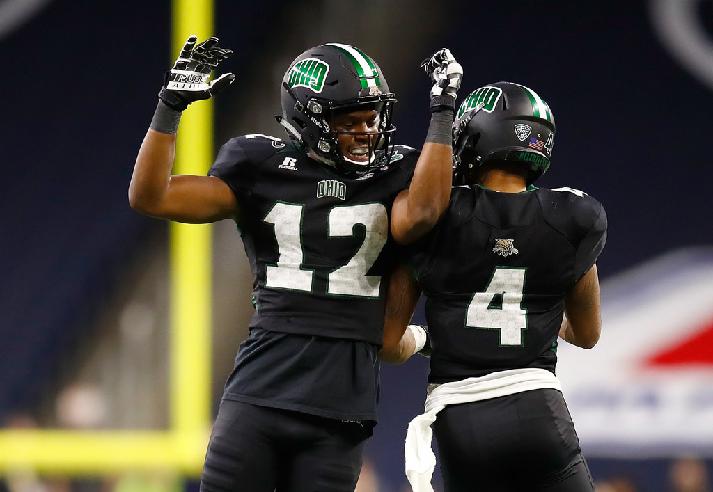 Ohio Bobcats wide receiver Papi White celebrates a touchdown with Jordan Reid against the Western Michigan Broncos in the 2016 MAC Championship game
