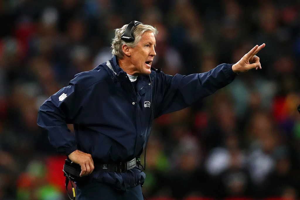 Seattle Seahawks head coach Pete Carroll giving his team instructions to go for two against the Oakland Raiders