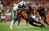 New York Jets wide receiver Quincy Enunwa gets tripped by the Cleveland Browns after making a receptions