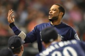 Former Seattle Mariners second baseman Robinson Cano celebrates a score against the Los Angeles Angels