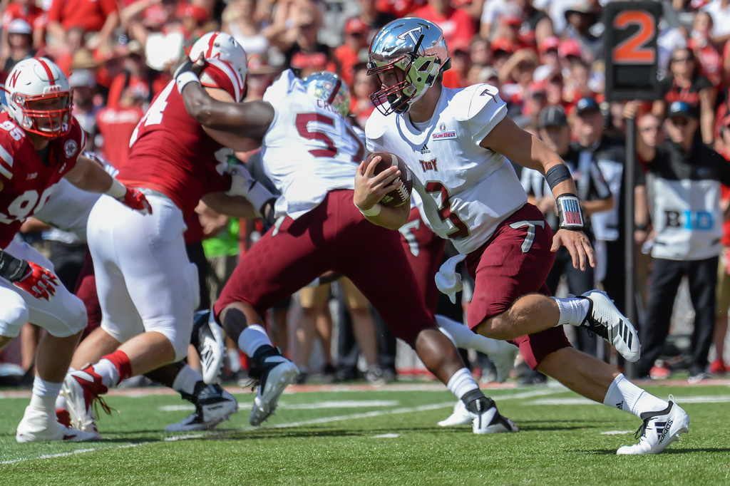 Troy Trojans quarterback Sawyer Smith rushing the ball against the Nebraska Cornhuskers