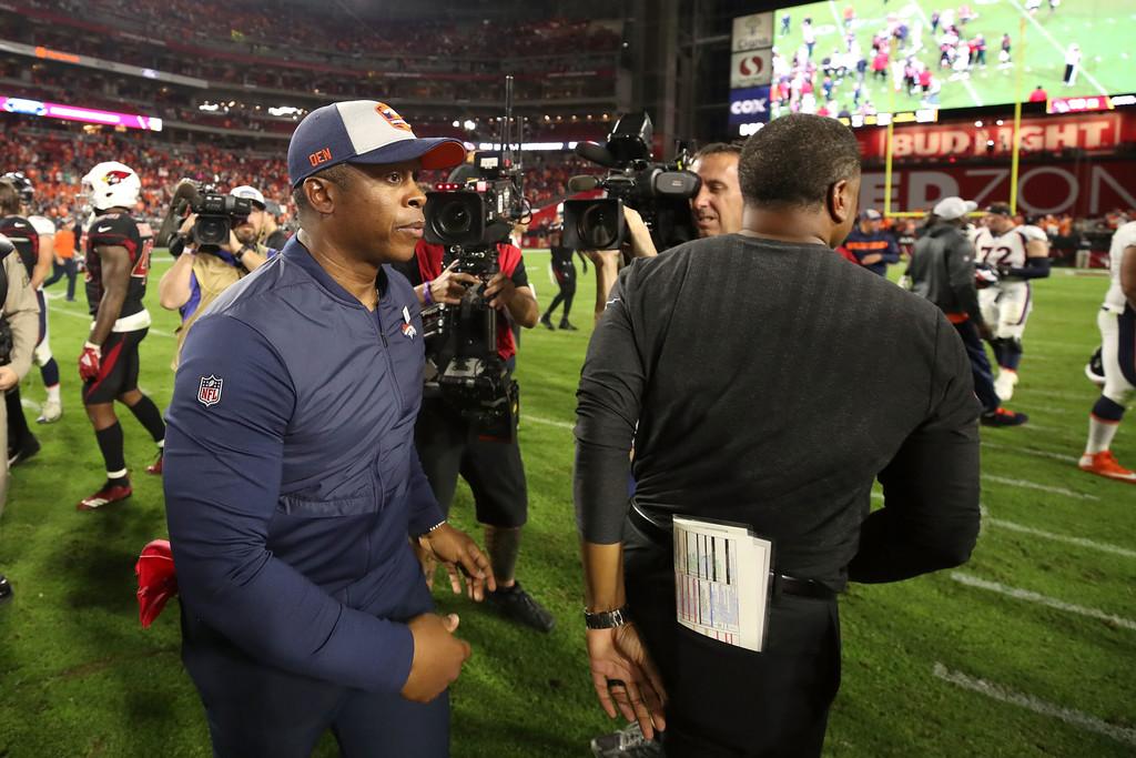 Denver Broncos head coach Vance Joseph walks off the field after greeting Arizona Cardinals head coach Steve Wilks following their game