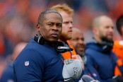 Former Denver Broncos head coach Vance Joseph stands on the field during the National Anthem before their game with the Los Angeles Rams
