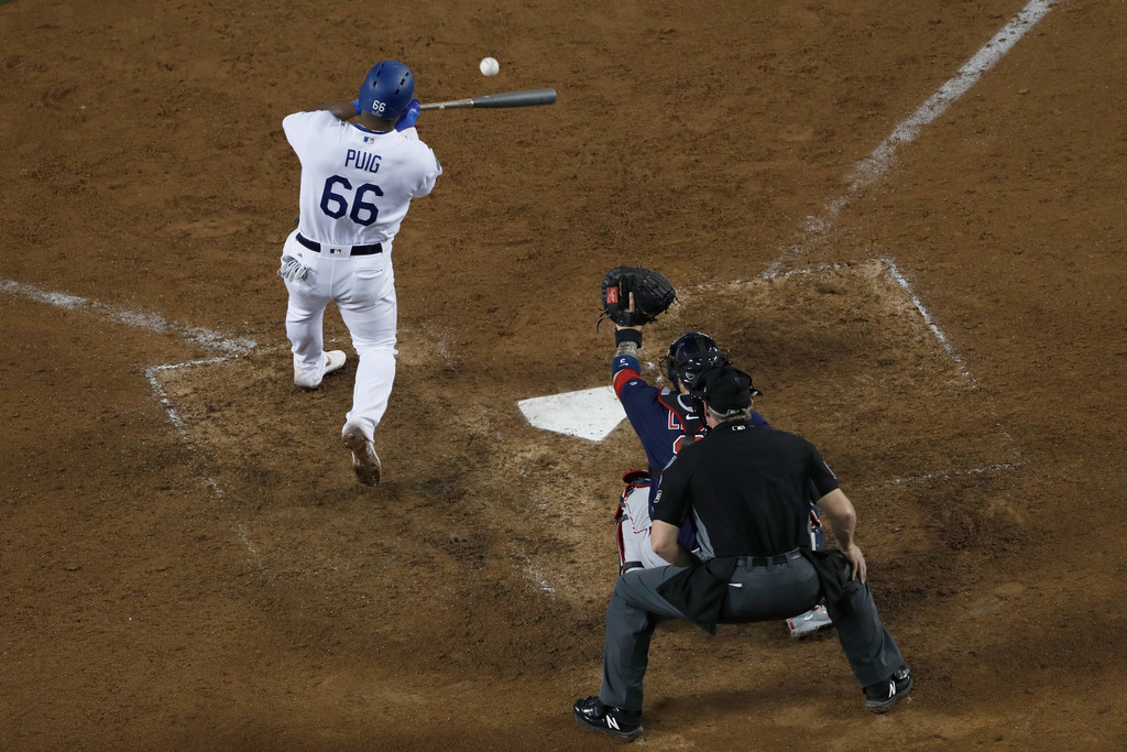 Former Los Angeles Dodgers outfielder Yasiel Puig hits a single against the Boston Red Sox in the 2018 World Series