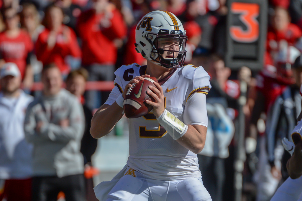 Minnesota Golden Gophers quarterback Zack Annexstad attempts a pass against the Nebraska Cornhuskers