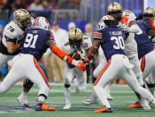 UCF Knights running back Adrian Killins Jr. running the ball against the Auburn Tigers in the Chick-fil-A Peach Bowl