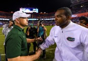 UAB Blazers head coach Bill Clark shakes hands with Florida Gators interim head coach Randy Shannon in 2017