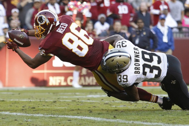Former New Orleans Saints cornerback Brandon Browner tackles Washington Redskins tight end Jordan Reed as he scores a touchdown