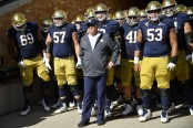 Notre Dame Fighting Irish head coach Brian Kelley stands in the tunnel with his team before the Pittsburgh Panthers game