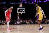 Former Houston Rockets forward Carmelo Anthony being guarded by his friend and Los Angeles Lakers star LeBron James