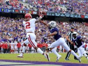 Oklahoma Sooners wide receiver CeeDee Lamb has a pass broken up by TCU Horned Frogs' Noah Daniels