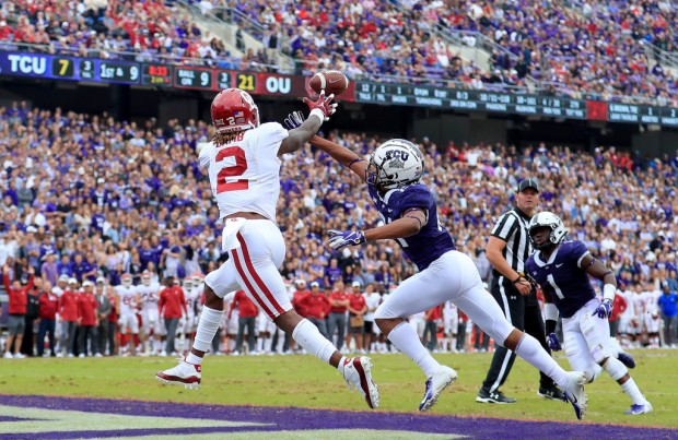 Oklahoma Sooners wide receiver CeeDee Lamb has a pass broken up by TCU Horned Frogs' Noah Daniels