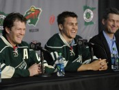 Former Minnesota Wild general manager Chuck Fletcher looks on as Ryan Suter and Zach Parise are introduced at a press conference