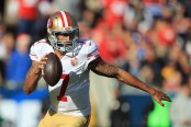 Former San Francisco 49ers quarterback Colin Kaepernick scrambles with the ball against the Los Angeles Rams