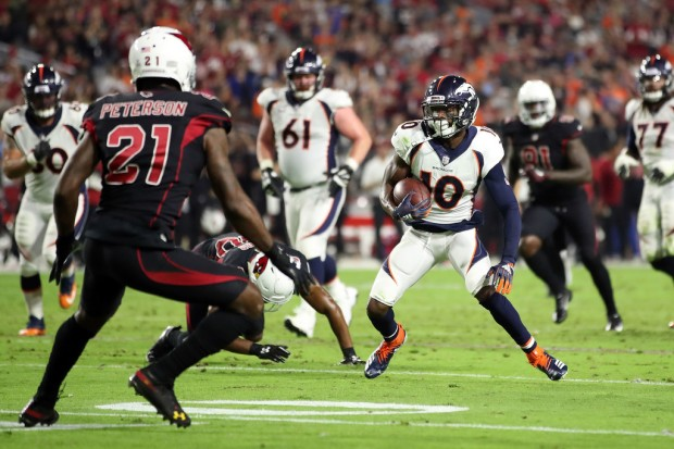 Denver Broncos wide receiver Emmanuel Sanders runs with the ball after making a reception against the Arizona Cardinals