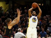Former Cleveland Cavaliers guard George Hill attempting to defend Golden State Warriors' Andre Iguodala's shot