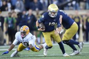 Notre Dame Fighting Irish quarterback Ian Book running the ball against the Pittsburgh Panthers