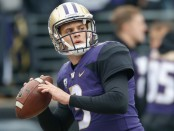 Washington Huskies quarterback Jake Browning warms up prior to the game with the Colorado Buffaloes