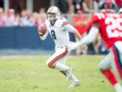 Auburn Tigers quarterback Jarrett Stidham scrambles with the ball against the Ole Miss Rebels