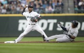 Former Seattle Mariners shortstop Jean Segura turns a double play against the New York Yankees