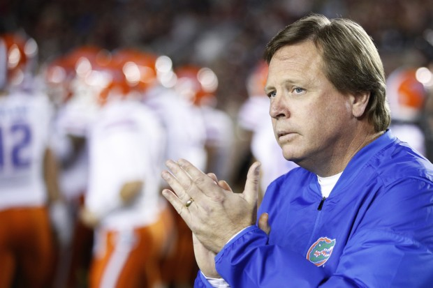 Former Florida Gators head coach Jim McElwain looks on before a game against the Florida State Seminoles