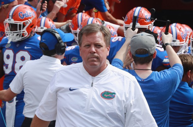 Former Florida Gators head coach Jim McElwain is seen on the field before a game with the Tennessee Volunteers