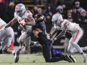 Ohio State Buckeyes running back J.K. Dobbins running the ball against the Purdue Boilermakers