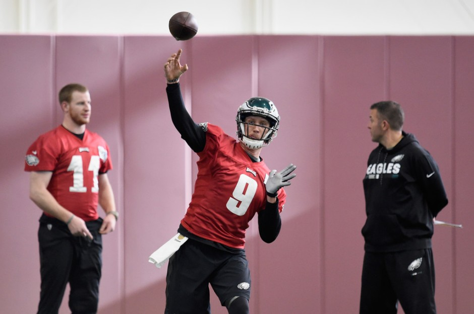 Former Philadelphia Eagles Quarterbacks Coach John DeFilippo looks on as Nick Foles attempts a pass during practice for the Super Bowl
