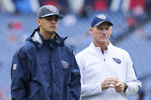 Former Tennessee Titans head coach Ken Whisenhunt looks on with an injured Marcus Mariota by his side