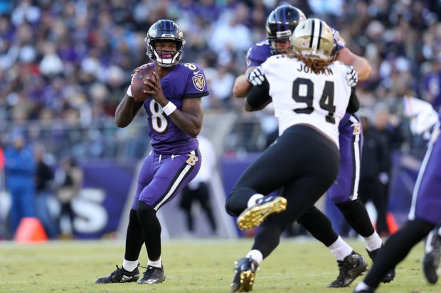 Baltimore Ravens quarterback Lamar Jackson dropping back for a pass against the New Orleans Saints