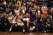 Los Angeles Lakers star LeBron James handles the ball against the Phoenix Suns