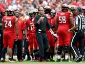 Former Maryland Terrapins interim head coach Matt Canada looks on from the sidelines against the Texas Longhorns