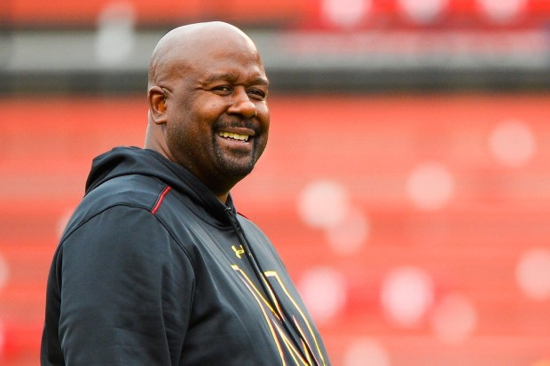 Former Maryland Terrapins Interim Head Coach Mike Locksley looks on prior to a game with the Rutgers Scarlet Knights