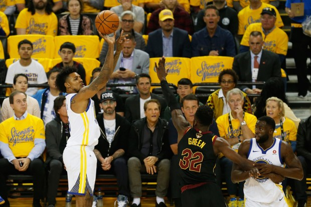 Former Golden State Warriors guard Nick Young attempting a jumper against Cleveland Cavaliers' Jeff Green