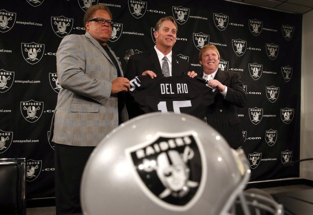 Former Oakland Raiders general manager Reggie McKenzie joins owner Mark Davis in introducing Jack Del Rio as head coach