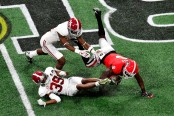 Georgia Bulldogs wide receiver Riley Ridley attempts to make a catch against the Alabama Crimson Tide in the CFP National Championship