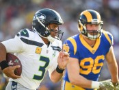 Seattle Seahawks quarterback Russell Wilson runs with the ball against the Los Angeles Rams