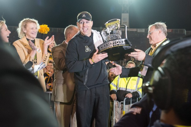 Appalachian State Mountaineers head coach Scott Satterfield holds the Dollar General Trophy after his team defeated the Toledo Rockets