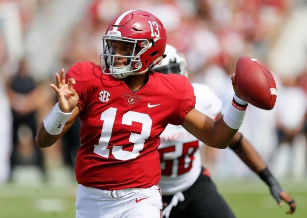 Alabama Crimson Tide quarterback Tua Tagovailoa rolls out for a pass against the Arkansas State Red Wolves